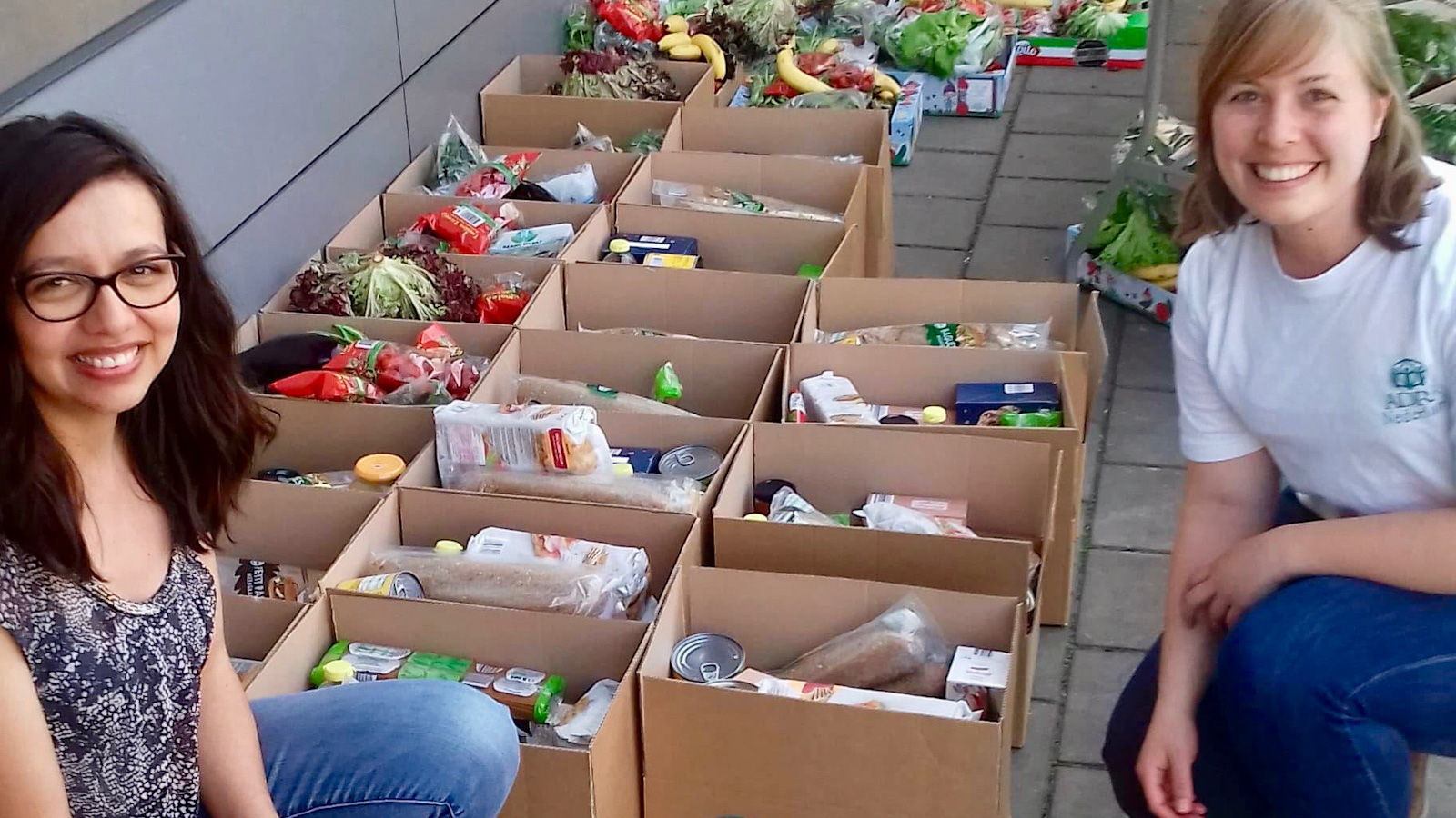 Ana and Esther help distribute food with ADRA in the Netherlands
