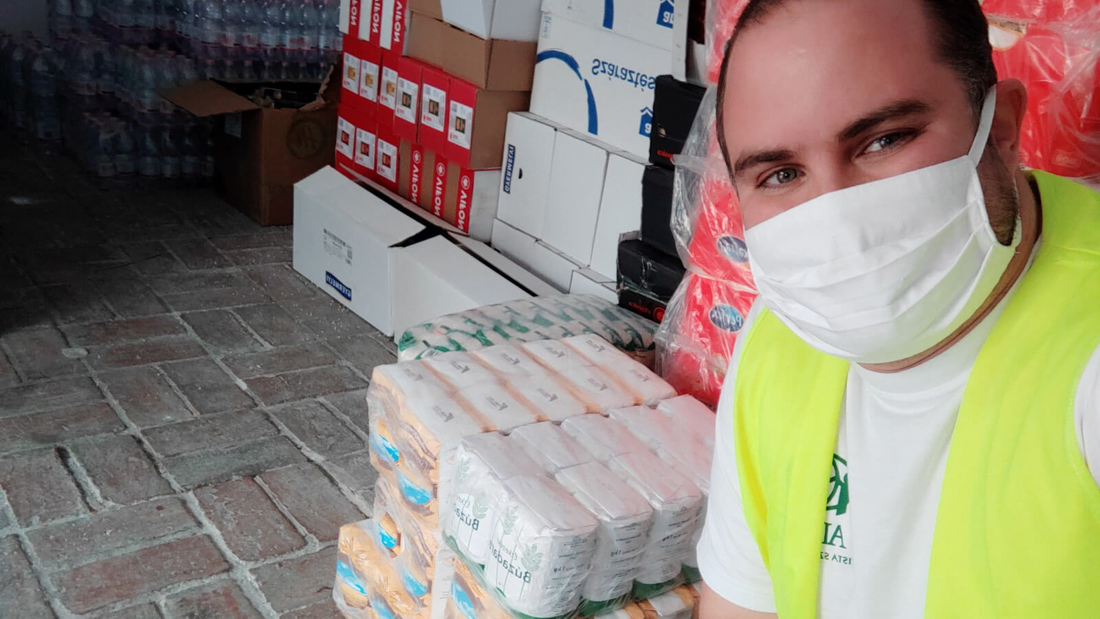 Volunteer at ADRA Hungary helps in preparing food packages