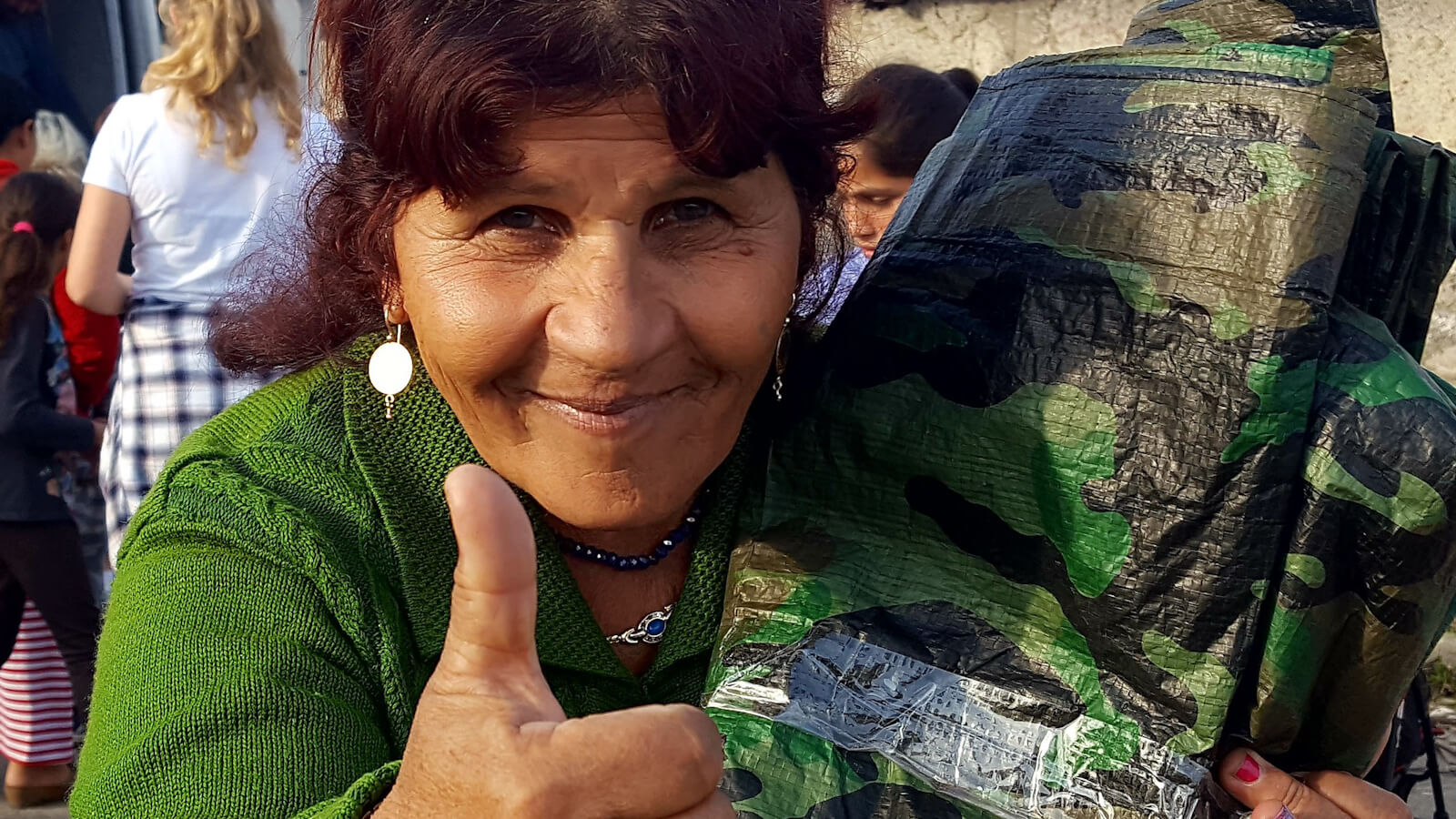 A Roma woman with a tarp
