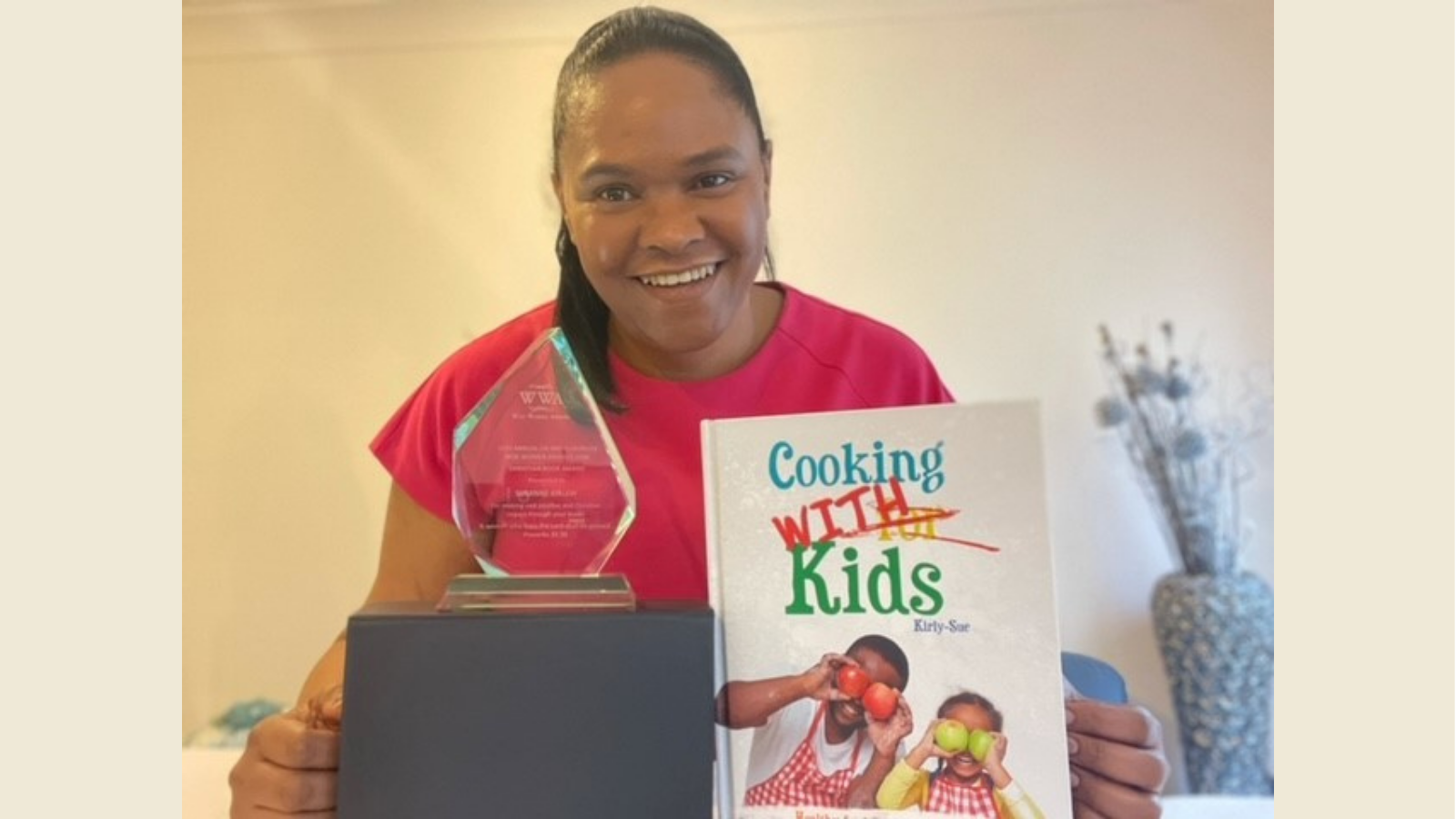 Kirly-Sue receives an award for her cookbook